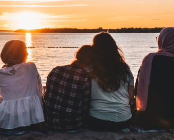 Four teenagers watching sunset