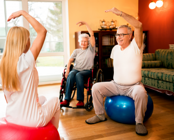 Two elderly patients doing exercises with healthcare professional
