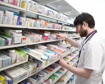 Pharmacist sorting out prescriptions