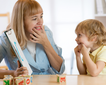 Speech and Language Therapist with young boy