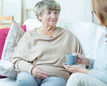 Social worker meeting with older woman