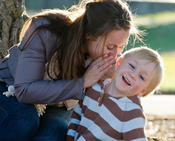 Young woman smiling with young toddler
