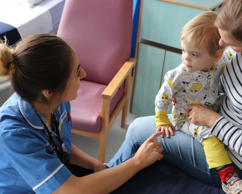 Nurse smiling with young patient