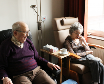 Elderly couple sitting in the house