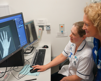 Staff looking at an x-ray at the Virtual Fracture Clinic